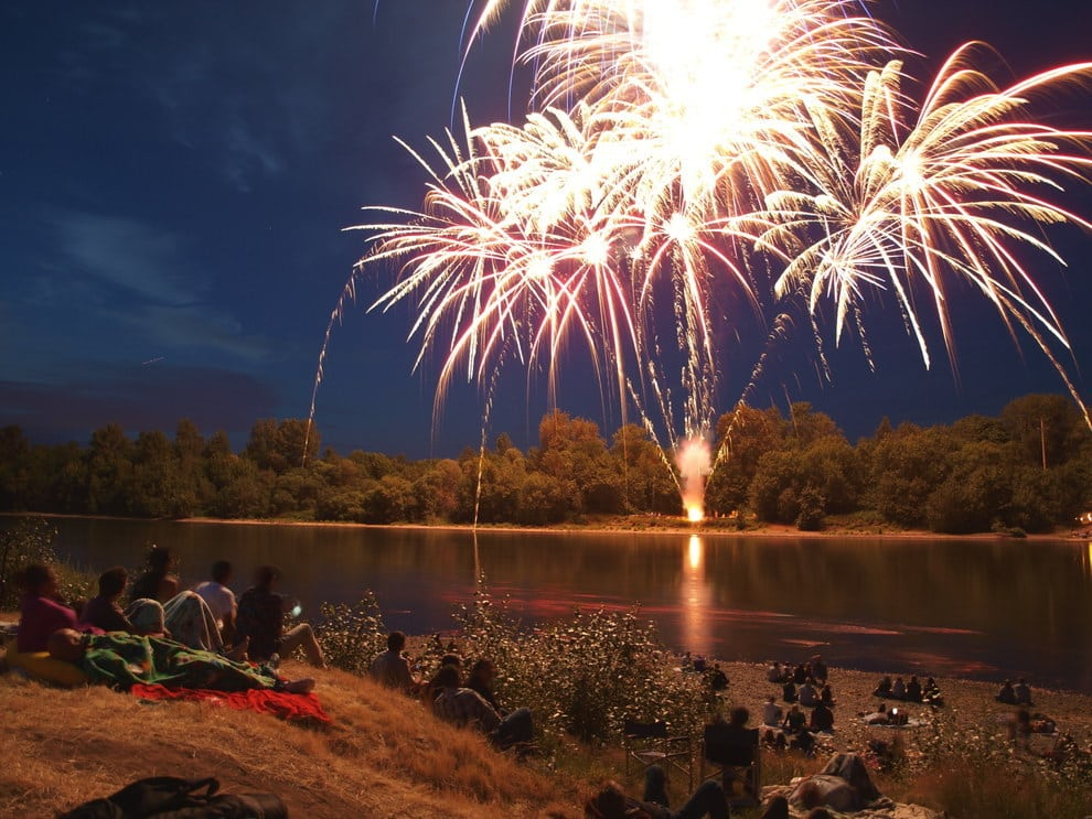 Fireworks burst over the Willamette River on the Fourth of July in Independence, Oregon.