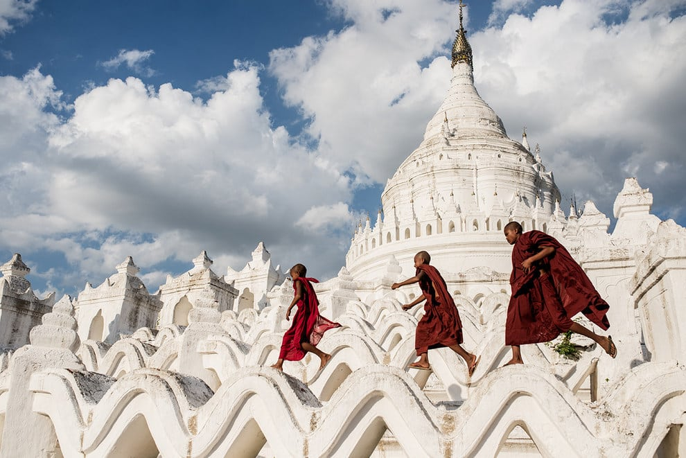 Young Buddhists play on the Hsinbyume Pagoda, Myanmar, after the tourists have left for the day.