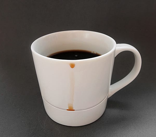 An insanely simple design for a coffee cup that catches all the drips.